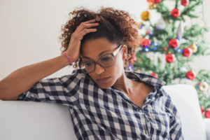 Here is a young African American woman struggling with social isolation. She could benefit from virtual counseling for her isolation and depression.